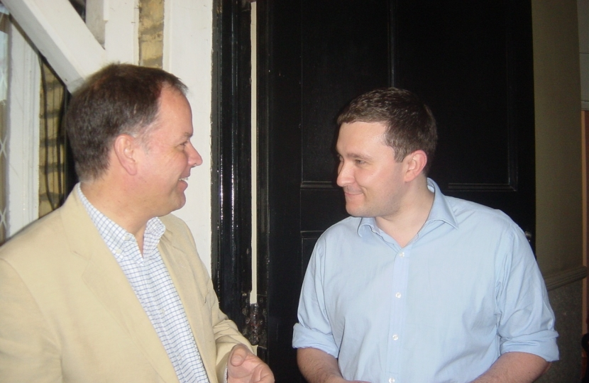 Michael talking with a Clapham resident during a campaign session